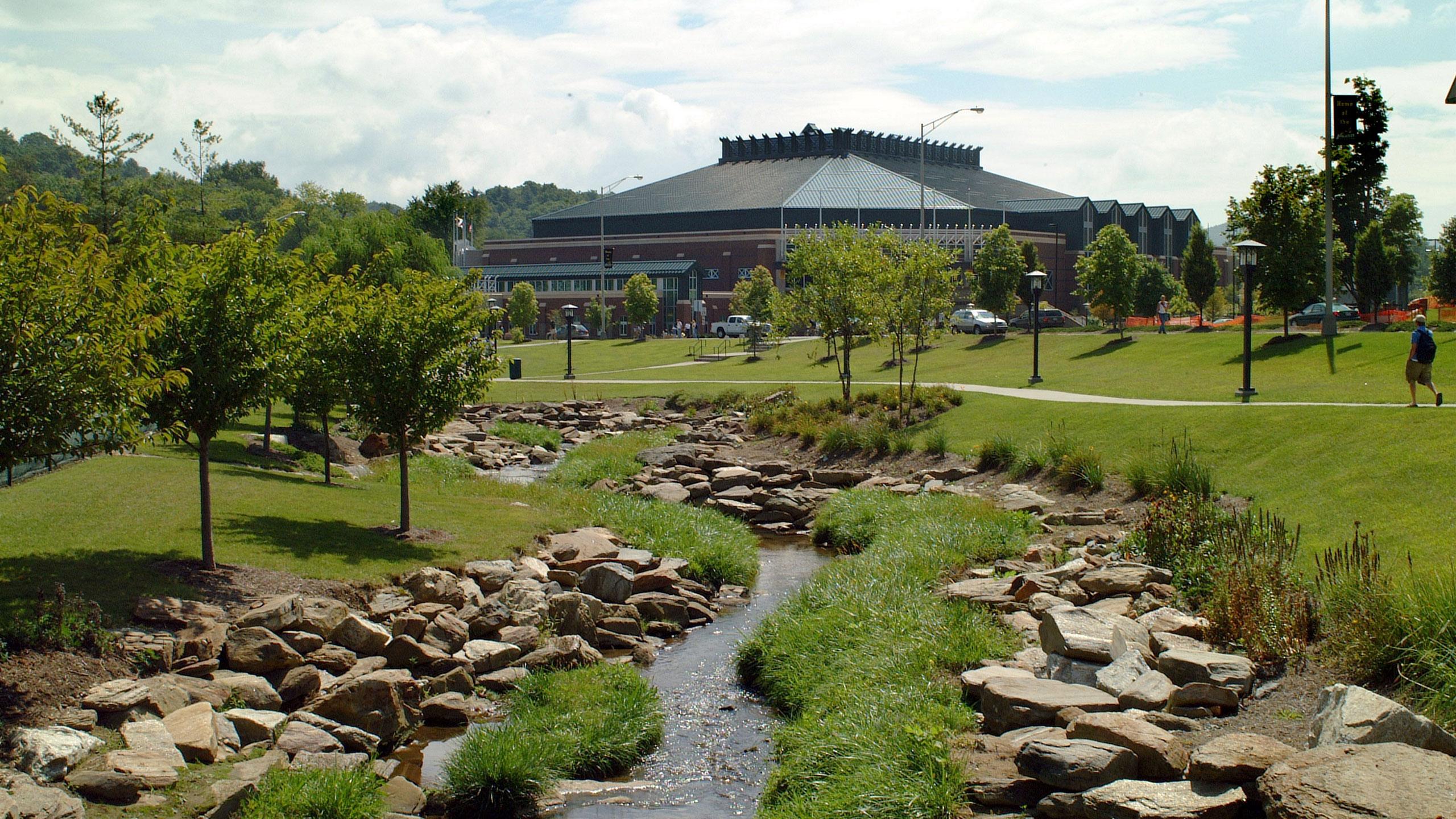holmes convocation center exterior with stream